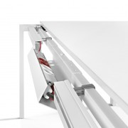 Cabling solution for sliding top single desks and desks with returns which makes assembly and installation easier and allows the user easy and convenient access to cables with a single movement. Top access lower tray included as standard as well as two cable management channels.